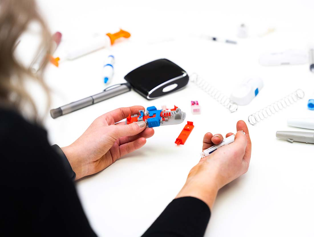 Design engineer reviewing a 3D printed medical prototype