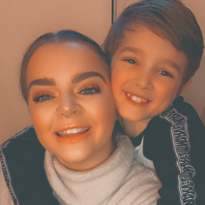 A selfie of Tayla, a medical device user with her son