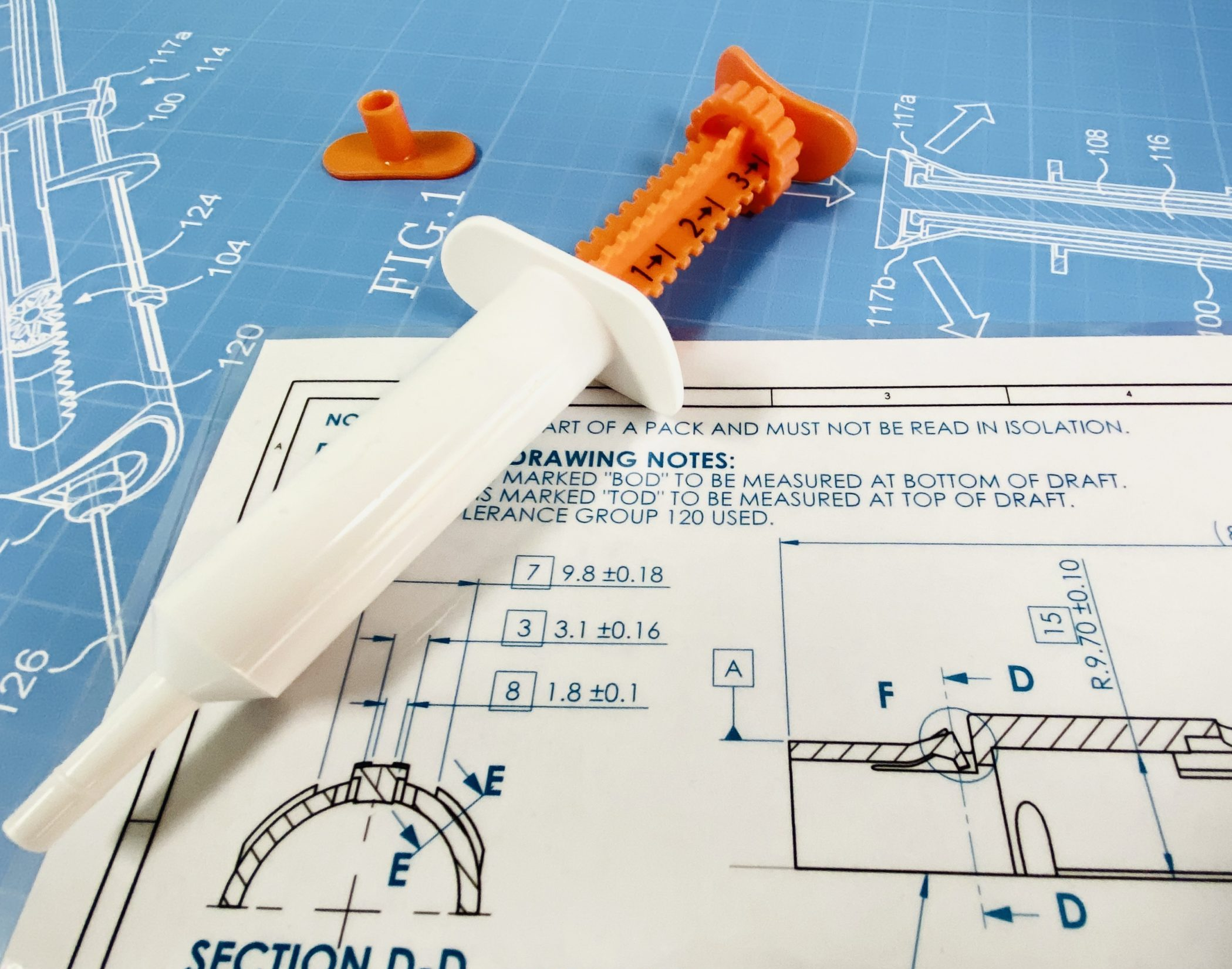Mechanical design and engineering drawing on a patent with syringe