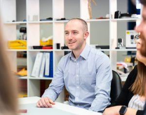 Medical Design Manager, Mark, in a design team meeting in a studio at Haughton Design