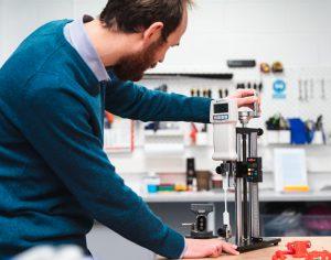 Chartered Design Engineer, Jack, testing prototyped parts for a novel medical device